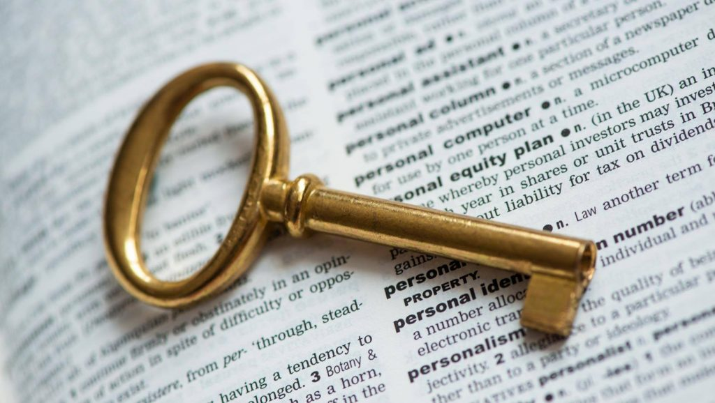 A golden key lying on a random page in a dictionairy. Get found on the right keywords